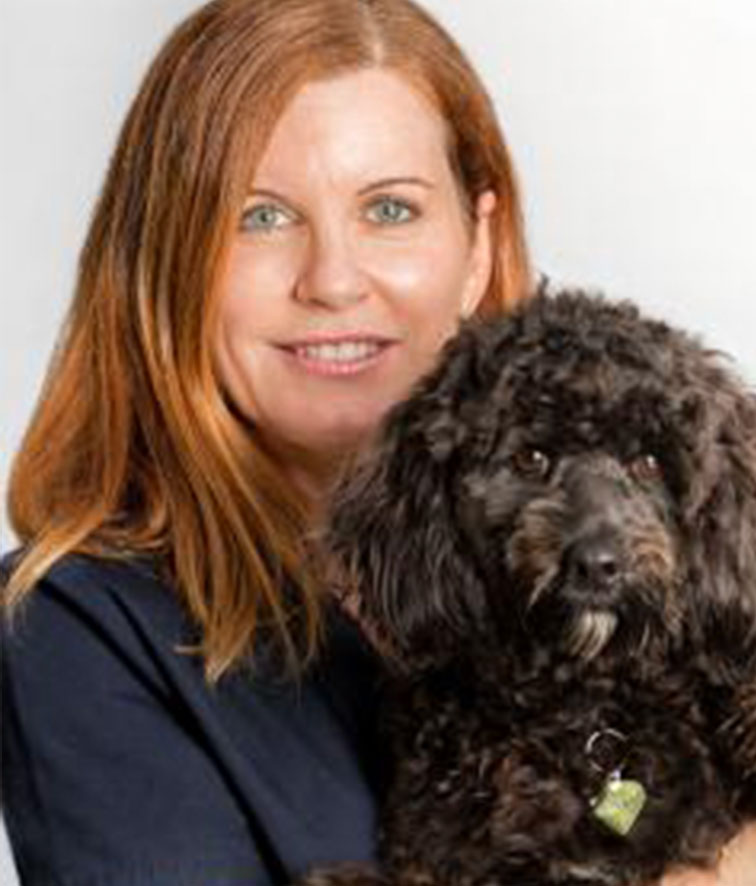 A photo of Justine Scarborough holding her dog.