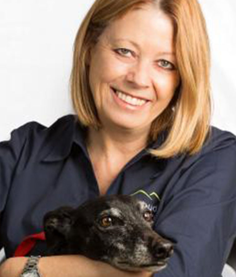 A photo of Sue Evans holding her dog.